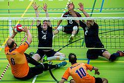 28-04-2018 NED: NK Zitvolleybal, Koog aan de Zaan<br /> BVC Holyoke wint de finale van het NK zitvolleybal met 3-1 van V.a.s. F.D.S uit Sneek. / Dominik Albrecht #6 of Holyoke, Luuk Adema #4 of Sneek, Rene van der Slot #6 of Sneek