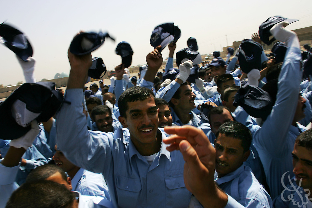 Iraqi police cadets celebrate following their graduation from the Baghdad Police academy June 29, 2006 in Baghdad, Iraq.