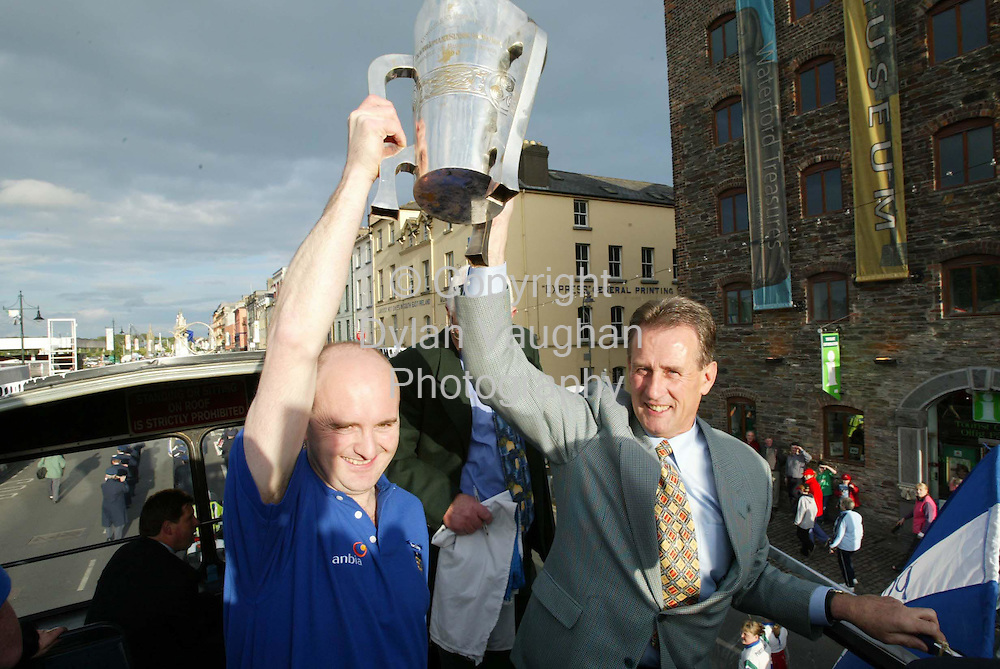 1/7/2002 Sunday Independent.Fergal Hartley (left) Captain and Justin McCarthy Manager lift the cup on the Quays of Waterford at last nights homecoming..Picture Dylan Vaughan