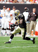 CLEVELAND - SEPTEMBER 10:  Rookie running back Reggie Bush #25 of the New Orleans Saints returns a punt while rushing, receiving, and returning punts for 141 total yards in his regular season professional debut against the Cleveland Browns at Cleveland Browns Stadium on September 10, 2006 in Cleveland, Ohio. The Saints defeated the Browns 19-14. ©Paul Anthony Spinelli *** Local Caption *** Reggie Bush