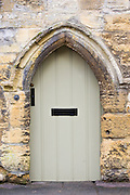 Front door of a period property in Burford in the Cotswolds, Oxfordshire, UK