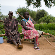 Women pose for a photo in the village of Kudo in South Sudan on 8 August 2014.