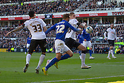 Birmingham City midfielder Andrew Shinnie (22) and Derby County defender Raul Albentosa (36) during the Sky Bet Championship match between Derby County and Birmingham City at the iPro Stadium, Derby, England on 7 March 2015. Photo by Aaron Lupton.
