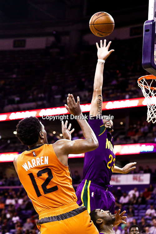 Feb 6, 2017; New Orleans, LA, USA; Phoenix Suns forward TJ Warren (12) shoots over New Orleans Pelicans forward Anthony Davis (23) during the second half of a game at the Smoothie King Center. The Pelicans defeated the Suns 111-106. Mandatory Credit: Derick E. Hingle-USA TODAY Sports