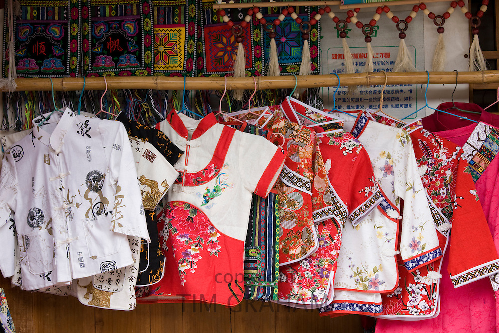 Chinese silk clothing souvenirs on sale in Ping An near Guilin, China