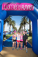 Susan Michelsson (Second), Tarli Bird (First), Karen Barlow(Third) and At The Finish Raelene Boyle. 2012 Sussan Women's Fun Run. St Kilda, Victoria, Australia. 02/12/2012. Photo By Lucas Wroe