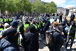 © Licensed to London News Pictures. 13/06/2020. London, UK. Protesters take part in a demonstration in central London organised by Black Lives Matter clash with the far righr in Trafalgar Square.<br />