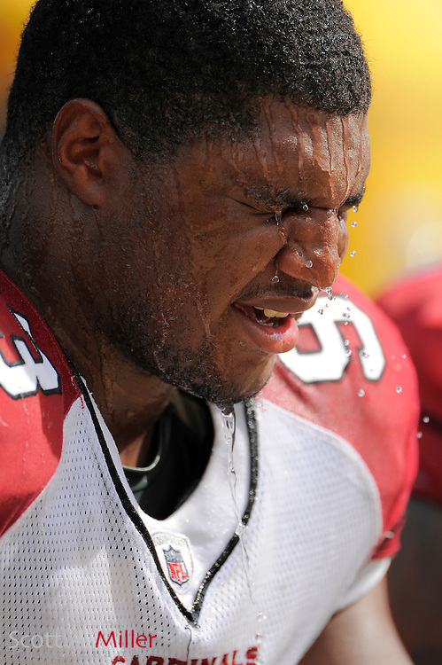 Sept 20, 2009; Jacksonville, FL, USA; Arizona Cardinals defensive end Calais Campbell (93) dumps water over his head to cool off during his team's game against the Jacksonville Jaguars at Jacksonville Municipal Stadium. Mandatory Credit: Scott A. Miller-US PRESSWIRE