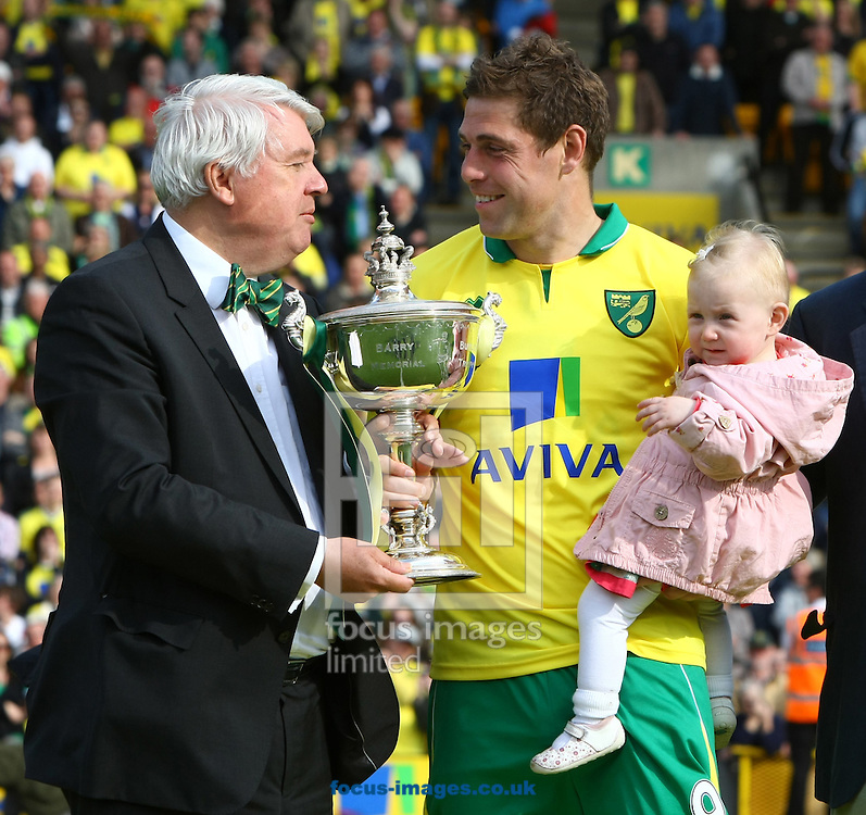 Picture by Paul Chesterton/Focus Images Ltd.  07904 640267.13/05/12.Grant Holt of Norwich receives his trophy for being the Player Of The Year after the Barclays Premier League match at Carrow Road Stadium, Norwich.