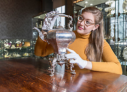 The Bonham's Home & Interiors Sale takes place on 21-22 February and features  a wide array of silver and porcelain.<br /> <br /> Pictured:Jaine Heggie of Bonhams with a rococo revival tea kettle and stand