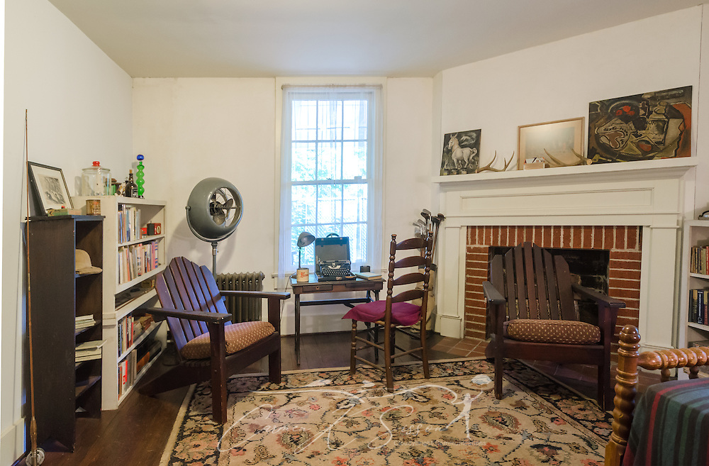 William Faulkner's typewriter is displayed prominently in his study, May 30, 2015, in Oxford, Mississippi. He often took the typewriter, table, and Adirondack chairs outside so he could enjoy the weather while writing. (Photo by Carmen K. Sisson/Cloudybright)