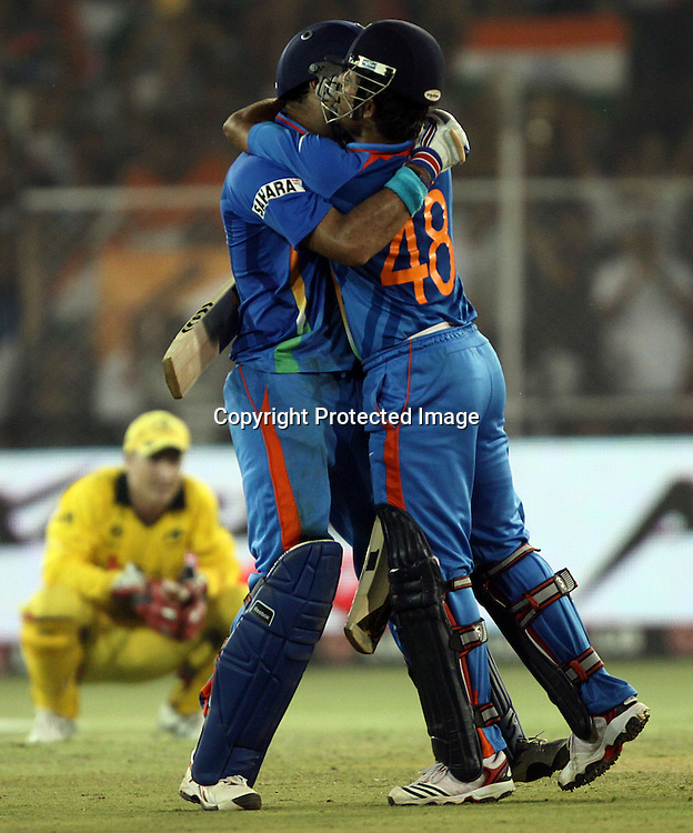 Indian batsman Yuvraj Singh and Suresh Raina celebrates After won the match against Australia during the 2nd Quarter-Final match India v Australia Played at Sardar Patel Stadium, Motera, Ahmedabad 24 March 2011 - day/night (50-over match)