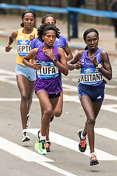 Mary Keitany, Kenya, leads the break at mile 19 on way to victory
