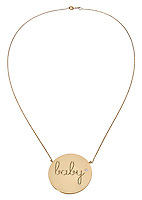 gold necklace with baby inscribed gold circle