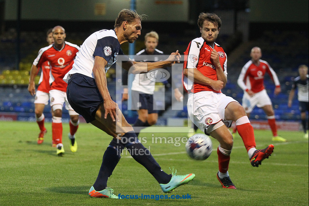 Mads Ibenfeldt of Southend and Andy Taylor of Walsall in action during the Capital One Cup First Round match at Roots Hall, Southend<br /> Picture by Paul Chesterton/Focus Images Ltd +44 7904 640267<br /> 12/08/2014