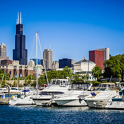 Photo of Chicago skyline with Burnham Harbor boats and yachts in downtown Chicago, Illinois. Picture is high resolution and was taken in 2010.