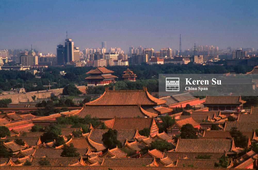 Panoramic view of Forbidden City with modern highrises Beijing China