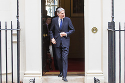 Downing Street, London, February 28th 2017. British Chancellor of the Exchequer Philip Hammond welcomes India's Finance Minister Arun Jaitley to his official residence, no 11 Downing Street.