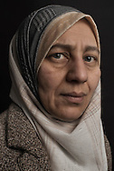 """Lebanon, Jbeil region.Hassiba Abdel Hassib 45, was forced to flee Homs almost four years ago. Their family house was destroyed in late 2011. Since then, she lives as officially registered refugee with her husband, Jassin Abdul Jalil (48) their three children Nidal (15), Yasmina (11) and Mohammed Taha (5), in Lebanon around the city of Jbeil/Byblos, about 35 km north of Beirut. Some relatives are still in Syria, but they can not be in touch with them anymore. """"The night when the bombs centered our house, I ran to enter my youngest child bedroom, I was afraid Mohammed was still asleep. I took him with me, I took our family book and we start to ran, as the bombing was going on. I arrived at the Lebanese border just with the clothes I was wearing that day. That's why the objects I care the most is our family documents. Within the pages is written our family memory. Ourselves"""". Alessio Romenzi"""