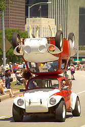 Stock photo of a man driving an upside down Volkswagen bug