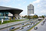 Traffic passes the BMW Customer Collection, Showroom, Museum, Headquarters and Factory in Munich, Bavaria, Germany