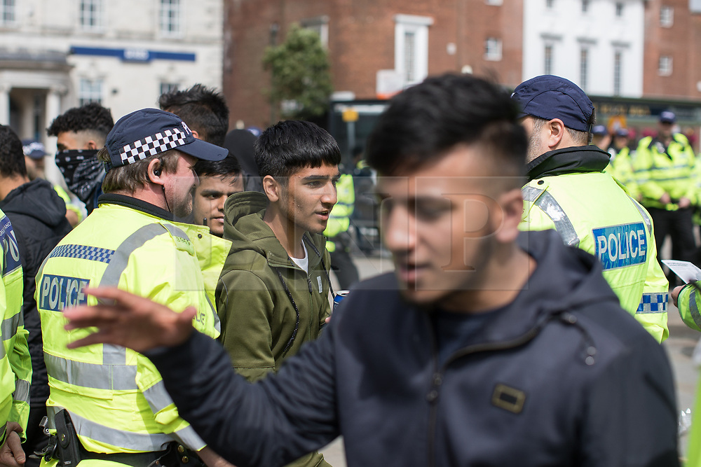 © Licensed to London News Pictures . 29/07/2017 . Rochdale , UK . Police detain Asian youths to Prevent a Breach of the Peace , and hand out dispersal notices , after an anti-fascist counter demonstration in the town . Far-right street protest movement , the English Defence League ( EDL ) , hold a demonstration in Rochdale , opposed by anti-fascists , including Unite Against Fascism ( UAF ) . The EDL say they are demonstrating against the sexual grooming and abuse of English girls by Muslim men in Rochdale and against terrorism across the UK . Photo credit : Joel Goodman/LNP