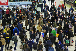 © Licensed to London News Pictures. 21/12/2018. London, UK. Crowds of people waiting for trains at London Waterloo Station as the annual festive Christmas getaway begins. This will lead to packed trains and congested motorways across the country leading to Christmas day. Photo credit: Dinendra Haria/LNP