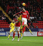 Charlton Athletic defender Harry Lennon rebuffing a Leeds united attack during the Sky Bet Championship match between Charlton Athletic and Leeds United at The Valley, London, England on 12 December 2015. Photo by Matthew Redman.