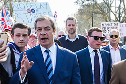 London, UK. 29th March, 2019. Nigel Farage joins pro-Brexit activists from Leave Means Leave marching from Fulham to a rally in Parliament Square in Westminster on the final leg of the March to Leave on the day on which the UK was originally to have left the European Union. The March to Leave was organised by Leave Means Leave, with assistance from Nigel Farage, as a peaceful protest 'to demonstrate the depth and breadth of popular discontent with the way Brexit has been handled' by the Government.