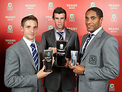 CARDIFF, WALES - Tuesday, October 4, 2011: Wales' award winners, Joe Allen (Young Player of the Year), Gareth Bale (Player of the Year) and Ashley Williams (Club Player of the Year) with their trophies at the FAW Footballer of the Year Awards 2011 held at the Wales National Museum. (Pic by David Rawcliffe/Propaganda)