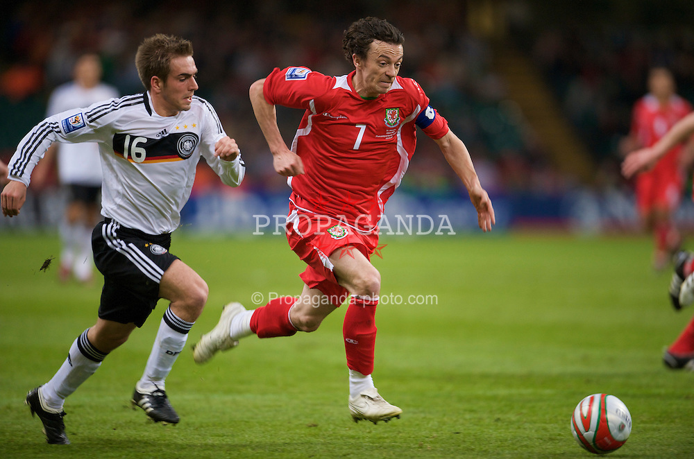 CARDIFF, WALES - Wednesday, April 1, 2009: Wales' captain Simon Davies and Germany's Philipp Lahm during the 2010 FIFA World Cup Qualifying Group 4 match at the Millennium Stadium. (Pic by David Rawcliffe/Propaganda)