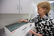 Director Jean Drulis explains the temperature requirements for the pasteurization process of the milk at the Mother's Milk Bank of Iowa in Coralville, Iowa on Friday, August 17, 2012.