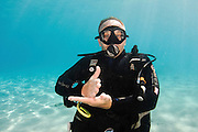 Underwater Hand signs scuba diver demonstrates the sign language for divers. Navigate: When using a compass, this signal is asking which direction to proceed.
