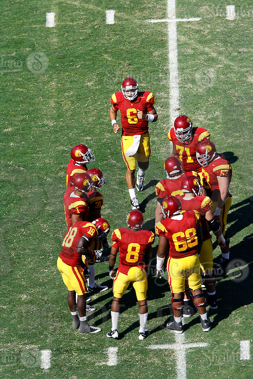 11 October 2008: NCAA Pac-10 USC Trojans 28-0 shut-out win over the Arizona State University Sun Devils during a day college football game at the Los Angeles Memorial Coliseum in Southern California. Trojans quarterback joining the huddle on the field.