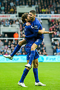 Jorginho (#5) of Chelsea celebrates with Marcos Alonso (#3) of Chelsea as Chelsea take the lead through an own goal (1-2) during the Premier League match between Newcastle United and Chelsea at St. James's Park, Newcastle, England on 26 August 2018.