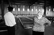 A couple in front of the 613 coffins looking for their son, victims of Srebrenica massacre.