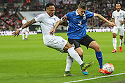 England's Nathaniel Clyne  tackles Estonia's Artur Pikk during the UEFA European 2016 Qualifier match between England and Estonia at Wembley Stadium, London, England on 9 October 2015. Photo by Shane Healey.
