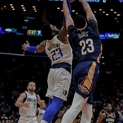 Dec 29, 2017; New Orleans, LA, USA; Dallas Mavericks guard Wesley Matthews (23) knocks a away a pass from New Orleans Pelicans forward Anthony Davis (23) during the second half at the Smoothie King Center. The Mavericks defeated the Pelicans 128-120.  Mandatory Credit: Derick E. Hingle-USA TODAY Sports
