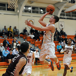 TOM KELLY IV &mdash; DAILY TIMES<br /> Marple Newtown's Nick Giordano (10) goes up for a layup over Garnet Valley's Jack Diggory (21) during the Garnet Valley at Marple Newtown boys basketball game on Tuesday night December 9, 2014.