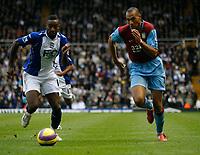 Photo: Steve Bond/Sportsbeat Images.<br /> Birmingham City v Aston Villa. The FA Barclays Premiership. 11/11/2007. John Carew (R) takes on Johan Djourou (L)