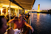 Andrea Csonka dines on the Delta King on the Sacramento River in Old Sacramento, California on August 15, 2015.
