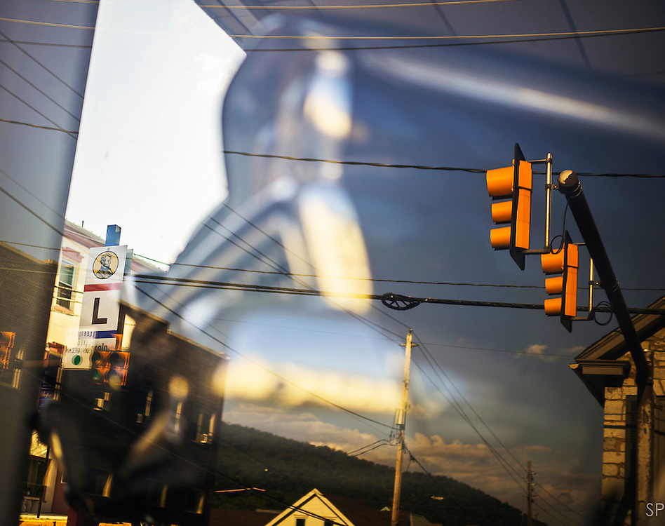 A classic car is reflected in a window in western Pennsylvania with a Lincoln Highway marker behind it. <br /> <br /> /// ADDITIONAL INFORMATION: 7/20/11 - travel.Lincoln.East.0929  - STUART PALLEY, ORANGE COUNTY REGISTER - Lincoln Highway July 2013.