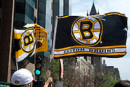 June 18, 2011, Boston, MA - Flags celebrating the Bruins were carried by fans all along the parade route.. Photo by Lathan Goumas