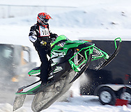 Colton Mousky of Marion gets some air at the Frozen Few 1st Inaugural Amateur Sno-X Race held at Hawkeye Downs, 4400 6th Street SW in Cedar Rapids on Saturday January 22, 2011. 1,200 people turned out to watch over 50 racers in 12 divisions at the event sponsored by the Frozen Few Snowmobile Club. A portion of the proceeds went to the Spina Bifida Association of Iowa. The next race is February 19th.