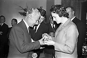 23/05/1963<br /> 05/23/1963<br /> 23 May 1963<br /> Esso Staff Golf Outing at Woodbrook Golf Club, Co. Dublin. Image from the prize giving after the event in the Golf Club. Mrs J. Donovan, wife of Esso Director, John Donovan, on right, presenting the prizes.