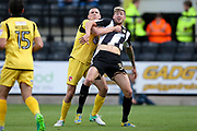 Morecambe defender Dean Winnard (6) challenges Notts County forward Jonathan Stead (30)  during the EFL Sky Bet League 2 match between Notts County and Morecambe at Meadow Lane, Nottingham, England on 9 September 2017. Photo by Simon Davies.
