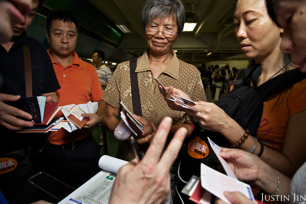 Mainland Chinese punters register for gambling at the Hong Kong Jockey Club's Shatin Racecourse.