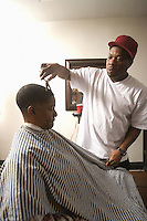 Barber cutting a young boys hair