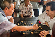 16 DECEMBER 2012 - SINGAPORE, SINGAPORE: Men play checkers in a public square in the Chinatown section of Singapore.      PHOTO BY JACK KURTZ