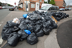 © Licensed to London News Pictures. 12/08/2016. Birmingham, UK. The strike by Birmingham bin men continues as they announce strike action up to Christmas. Pictured, rubbish building up in Clodesall Road, Alum Rock. Photo credit: Dave Warren/LNP